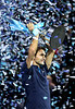 Roger Federer of Switzerland celebrates winning the ATP World Tour Finals 2011