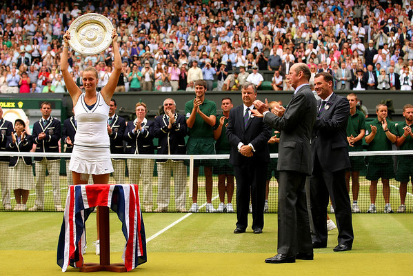 Petra Kvitova receives the Venus Rosewater Dish from the Duke of Kent following her win in the Final at Wimbledon, 2011