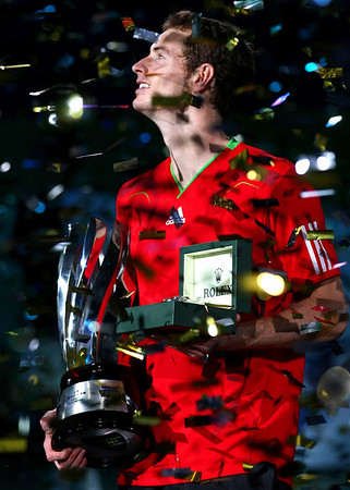 Andy Murray holds the trophy following his victory in the Rolex Masters in Shanghai