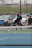 Findlay's #1 Max Hose sends a serve over the net against his St. John's opponent.