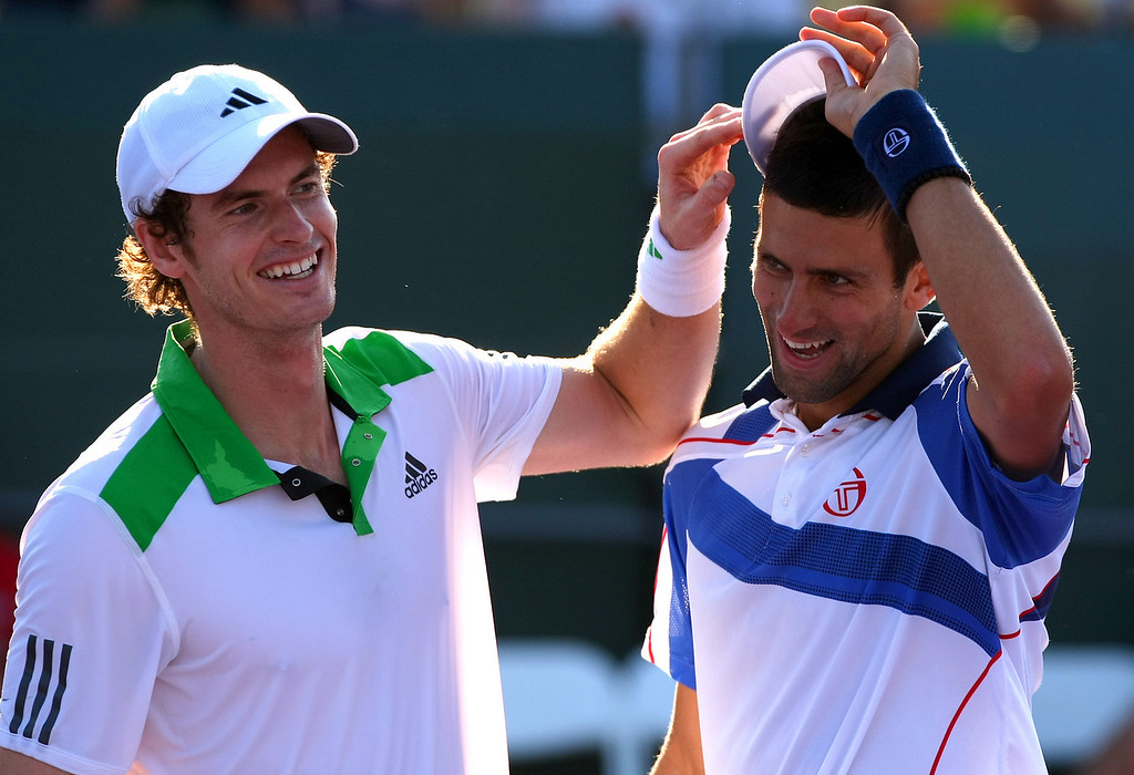 Andy Murray of Great Britain and Novak Djokovic of Serbia in doubles action in Miami
