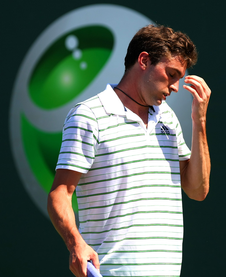 Gilles Simon of France reacts in frustration in Miami