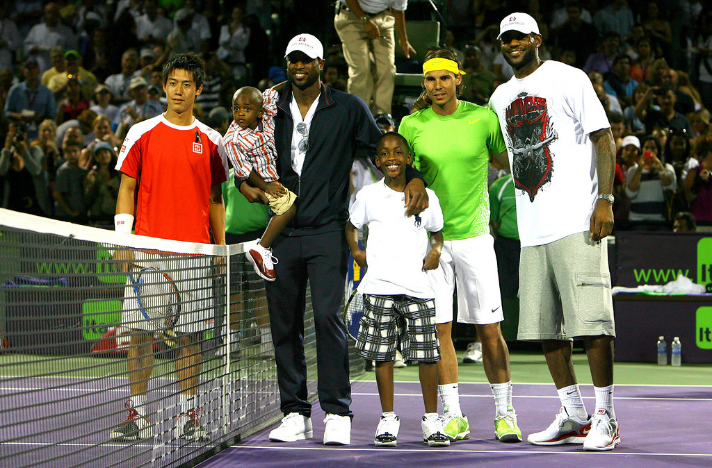 Rafael Nadal of Spain stands with LeBron James, Dwyane Wade and his kids, and Kei Nishikori of Japan in Miami