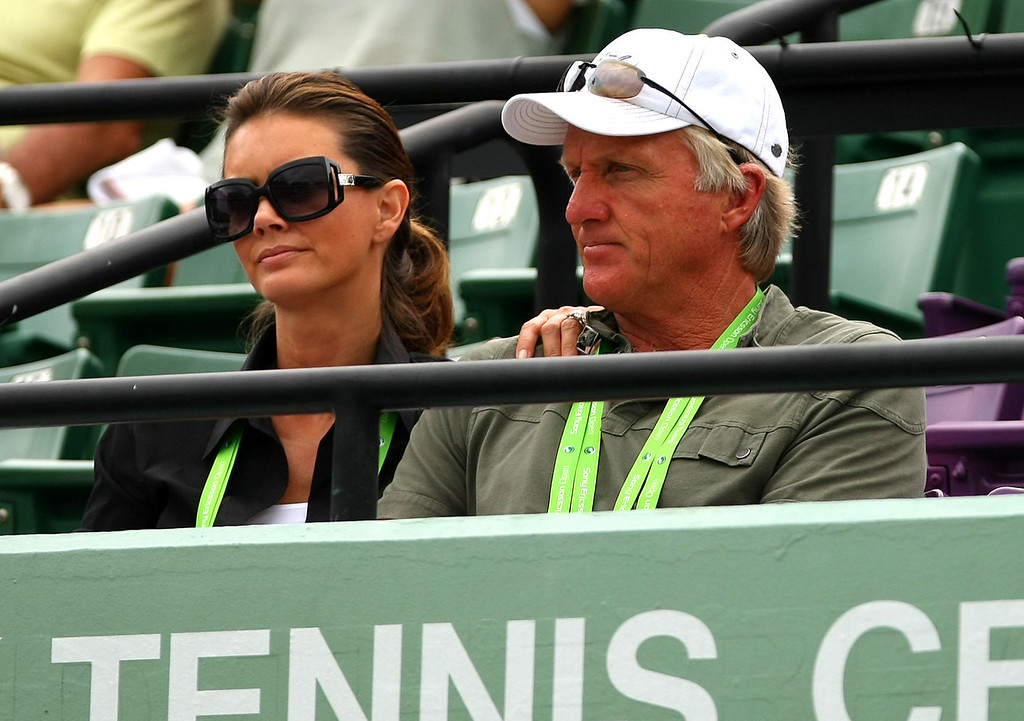 Greg Norman and his new girlfriend watch Sam Stosur of Australia in action in Miami