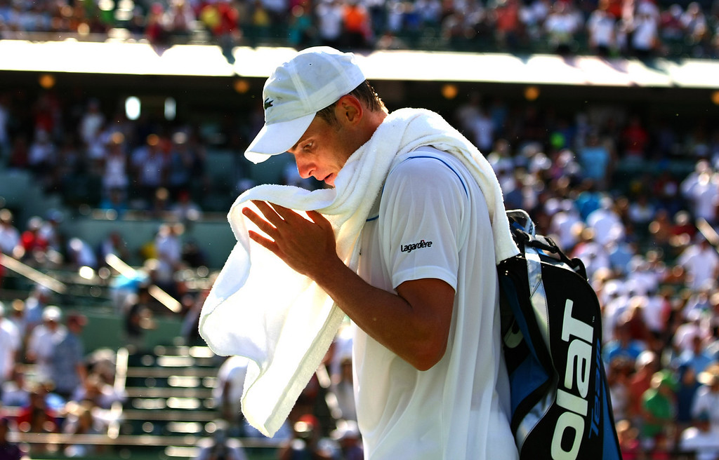 Andy Roddick of USA walks off court following his defeat in Miami
