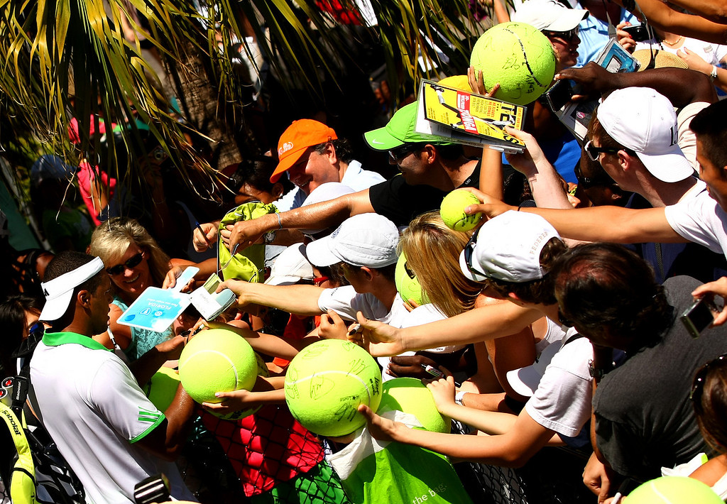 Jo-Wilfried Tsonga of France signs autographs in Miami
