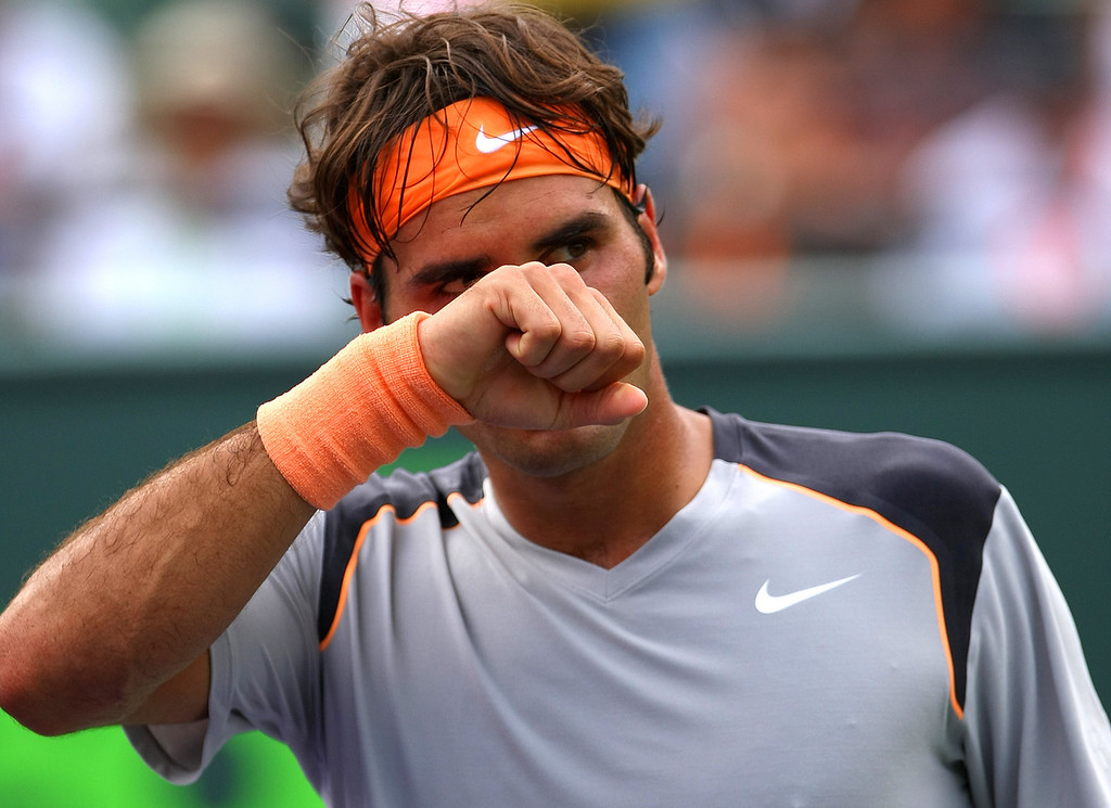 Roger Federer of Switzerland pumps his fist in Miami