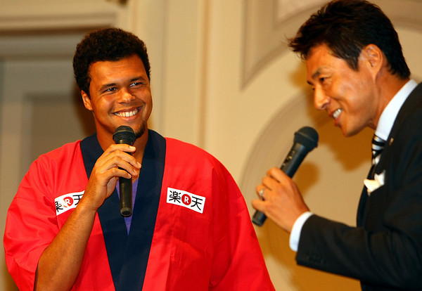 Jo-Wilfried Tsonga of France speaks with Shuzo Matsuoka