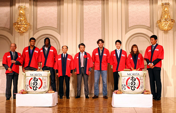 Rafael Nadal of Spain, Jo-Tsonga of France, Gael Monfils of France, Kei Nishikori of Japan and Ayumi Morita of Japan smash open a drum of Sake at the players party prior to the start of the Rakuten Open, Tokyo, 2010