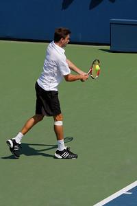 Juan Carlos Ferrero ESP (24) def Gilles Simon FRA (9) 1-6 6-4 7(7)-6(5) 1-0 (retired)