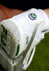 125 years of Wimbledon is stitched on the ball kid's shoes at Wimbledon 2011