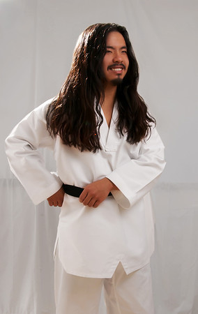 Martial artist. Photo shoot where Teresa Callen took the opportunity to show off his amazing natural waves. Male grooming by Tysa Rauch.