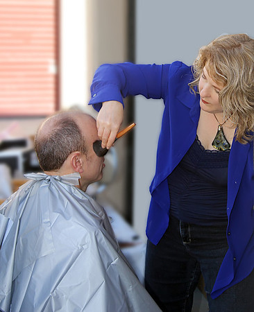 Teresa Callen grooming the author of a book for his publicity photo shoot.