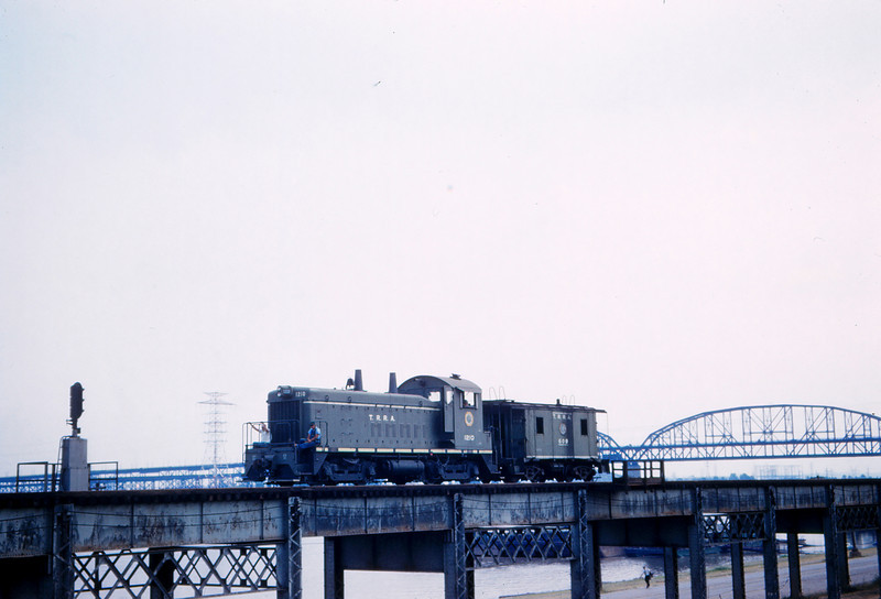 TRRA 75 - Sept 4 1960 - EMD Eng  & Caboose on riverfront highline St Louis MO
