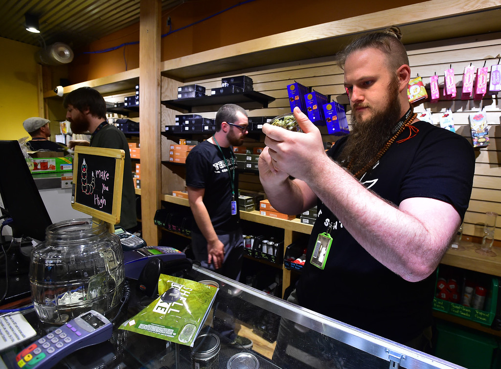 . Bradd Rigoni, the Director of Store Operations, at Terrapin Care Station, works on setting up a display case at their store in Boulder on Monday.  Paul Aiken Staff Photographer July 2, 2018