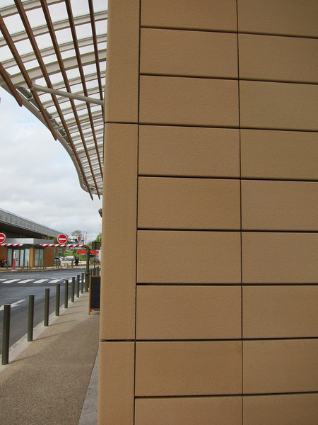 Small commercial shopping complex (and Subway) that used our reinforced double skin ZEPHIR tile.  Color is Champagne with a sanded surface.  This project used a wider horizontal rail to increase the horizontal reveal and used corner tiles that were made in Revel.
