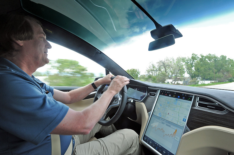 Bruce Robinson drives his brand new Tesla X on Wednesday, May 11, 2016, in south Loveland. He and his wife, Linda Robinson believe this is the first production model Tesla X in Colorado. (Photo by Jenny Sparks/Loveland Reporter-Herald)
