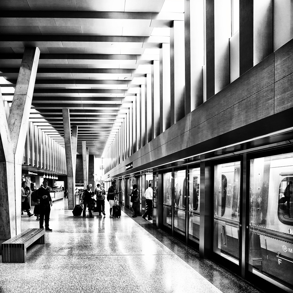 Passengers board the new UP Express train that links Toronto to Lester-Pearson International airport. The modern terminal building that features natural light and natural wood elements was designed by Zeidler Partnership Architects.