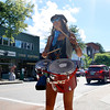 Krista Soeroni of North Adams, MA dances and drums to the beat on Main St.