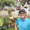 Buzz + Thrive Gardens owner Patrick Hillman in one of his two greenhouses.<br /> SENTINEL & ENTERPRISE / Peter Jasinski