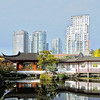 Chinatown apartment buildings reflections in Chinese Gardens of Vancouver, Canada - a color image