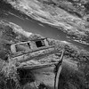 A black and white image of an abandoned boat on Virginia's Eastern Shore
