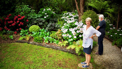 Liz Morrow in her garden, Omaio, north of Auckland