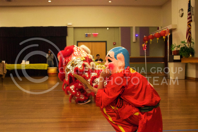 St. Anthony's lion dance team ends the performance with a bow at the New Years festival at the union on Feb. 04, 2017. (Kelly Pham | The Collegian)