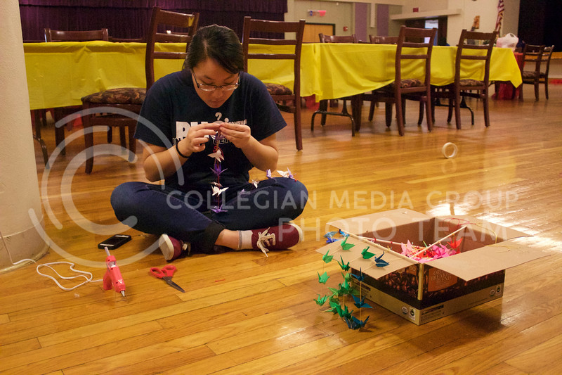 Senior in anthropology and secretary of VSA Susann Yang making last minute preparations for the New Years event at the student union on Feb. 04, 2017. (Kelly Pham | The Collegian)