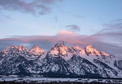 Morning light sweeping across the Tetons