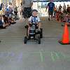 3-year-old Grady Jansen pedals to a full pull in 7.62 seconds in the 34 year old age division during the Tot Rod Pedal Tractor Pull in Teutopolis Saturday afternoon as part of the Terquasquicentennial anniversary celebration.