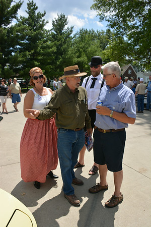 Dan Printa points something out to Paul Beckman as Gina, left, and Bob Zerrusen look on Sunday.