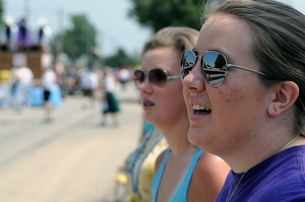 Lacey Brandt of Beecher City watches the parade along Main Street Sunday afternoon as part of Teutopolis's Terquasquicentennial anniversary celebration. Brandt's mother is a Teutopolis native.