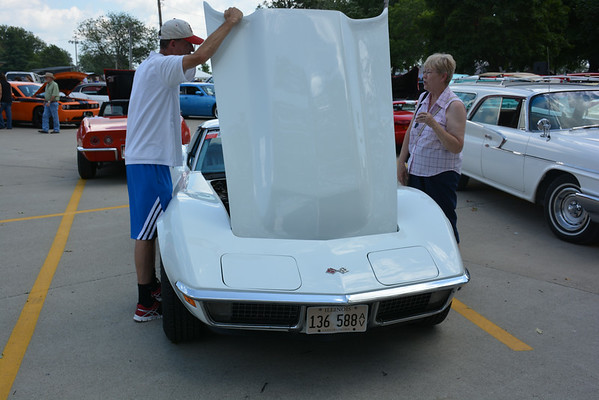 David Donaldson, left, shows off his 1970 Corvette to mom Sandi at Sunday's car show.