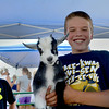 Katie Smith | Effingham Daily News <br /> Joel Deters holds a baby goat at a petting zoo set up for the Teutopolis 175 Anniversary Celebration Friday, August 1, east of Teutopolis grade school.