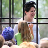 "Angela Sheehan,the principal at Teutopolis Grade School, is arrested by the Keystone Cops during the students' recess Thursday. Sheehan was given a fictional ticket and released with two charges of not having long enough recess and not wearing a 175 Teutopolis Anniversary pin. One of Sheehan's students who tried to prevent the Keytston Cops from arresting the principal, whispered to Sheehan through the prison bars, ""I tried my best,"" Sheehan said."