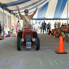 First Lady Jeannie Gaddis Throws her hands in the air after showing the participants in the Tot Rod Tractor Pull how to pedal to a full pull Saturday afternoon during Teutopolis' Terquasquicentennial anniversary celebration.