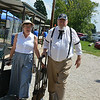 Dressed in period attire, Deb and Dick Runde of Teutopolis look for a place to sit on a Sunday afternoon during the Teutopolis 175th anniversary celebration.