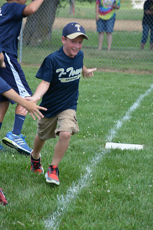 Adam Lustig rounds third base after smacking a home run in Sunday's wiffle ball tournament.