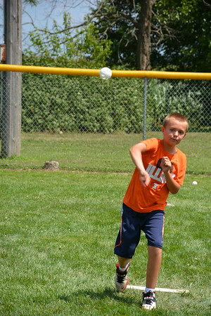 Peyton Tegeler delivers a pitch during Sunday's wiffle ball tournament in Teutopolis.