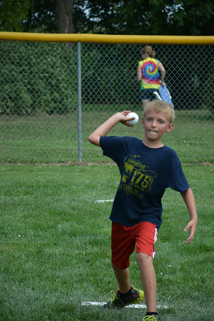 Colin Probst delivers a pitch during Sunday's wiffle ball tournament.
