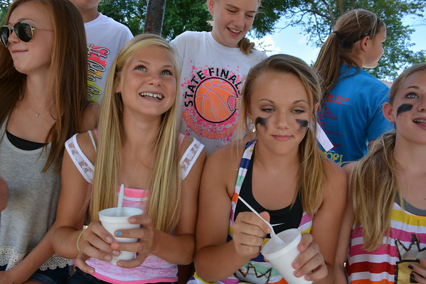 Morgan Mette, left, and Julia Schmid enjoy a cold treat on a muggy Sunday afternoon in Teutopolis.