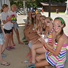 These girls spent much of Sunday's afternoon sitting in the third base dugout at the KC ball diamond Sunday.