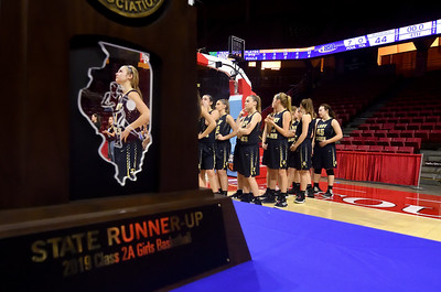 Teutopolis' Morgan Mette (1) looks up at the scoreboard during the awards ceremony after being defeated by Chicago Marshall in the IHSA Class 2A Girls basketball state championship game at Illinois State University's Redbird Arena Saturday evening.  Chet Piotrowski Jr. photo/Piotrowski Studios