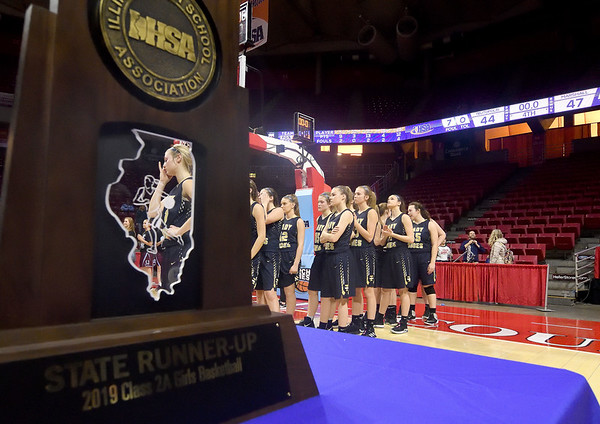 Teutopolis' Morgan Mette (1) wipes away a tear during the awards ceremony after the Lady Shoes were defeated by Chicago Marshall in the IHSA Class 2A Girls basketball state championship game, 47-44, at Illinois State University's Redbird Arena Saturday evening.<br /> <br /> Chet Piotrowski Jr. photo/Piotrowski Studios