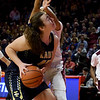Teutopolis' Claire Bushur (45) is hit in the face by Chicago Marshall's Jalyn Jimenez (12) during the awards ceremony after being defeated by Chicago Marshall in the IHSA Class 2A Girls basketball state championship game at Illinois State University's Redbird Arena Saturday evening.<br /> <br /> Chet Piotrowski Jr. photo/Piotrowski Studios