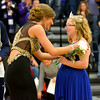 Retiring queen Kayla Kroeger, left, talks with 2016 queen Mikaele Deters, right, after Deters was crowned homecoming queen Friday night at Teutopolis High School. Ryan Czachorski photo