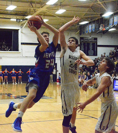 Teutopolis' Clint Weber goes for the block on Newton's Justin Zumbahlen.