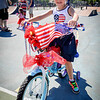 Kaylee Horsman, 6, of Tewksbury shows off her decorated bike after winning the bike contest. SUN/Caley McGuane
