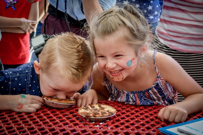 From left, Ryan Pasquariello, 3, and Arianna Ciampa, 6, both from Tewksbury compete in the pie eating contest. SUN/Caley McGuane